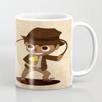 indiana jones Mugs featuring Indiana Jones by Delucienne Maekerr