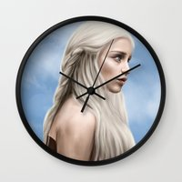 daenerys Wall Clocks featuring Khaleesi (Blue Sky) by Jason Cumbers