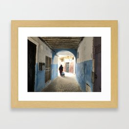 Moroccan lady walking in the Casbah Framed Art Print