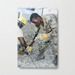 An Armed Forces of Liberia engineer cutting wood braces for the Tubmanburg Ebola treatment unit (ETU Metal Print