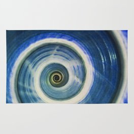 Blue and white spiral shell Rug