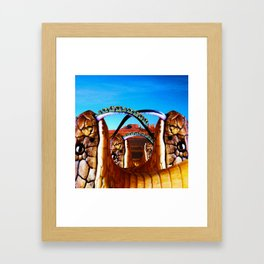 Ride the snake Framed Art Print