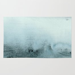 dissolving blues Rug