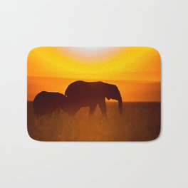 Elephants in the sunset Bath Mat
