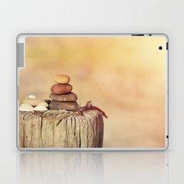 Balanced stone cairn in sunset light Laptop & iPad Skin