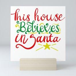 THIS HOUSE BELIEVES IN SANTA Mini Art Print