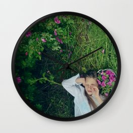 girl laying down in cu meadow Wall Clock