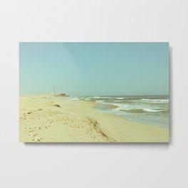 Lighthouse on a sandy beach Metal Print