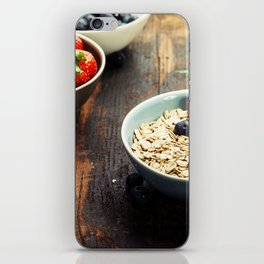 Bowls with cereals and fresh berries on wooden table iPhone Skin