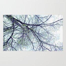Tree reverse perspective, green leaves, blue sky Rug