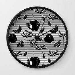 Pattern with a croissant, apples, strawberries and flowers. Black and white. Wall Clock