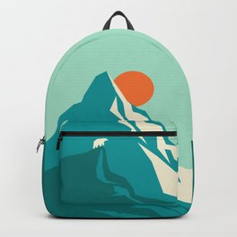 As the sun rises over the peak Backpack