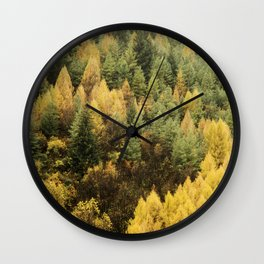 Autumn colour on hillside of trees Wall Clock