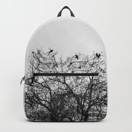 A murder of crows sitting in a tree Backpack