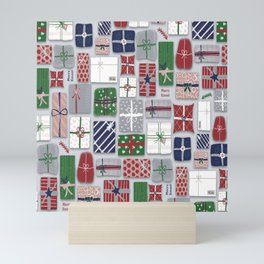Christmas parcels on gray Mini Art Print