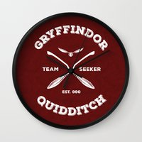 gryffindor Wall Clocks featuring Gryffindor Quidditch by Sharayah Mitchell