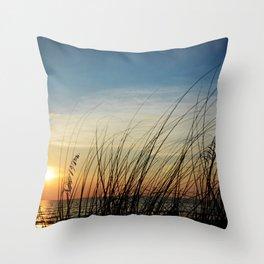 Sunset through the sea weeds Throw Pillow