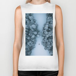 Man lying in the snow on a frozen lake in a winter forest - Landscape Photography Biker Tank