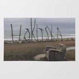 hokitika street art at coast line with seat in new zealand Rug