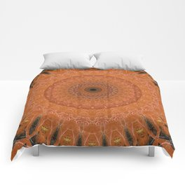 Ornamented mandala in orange tones Comforters