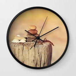 Balanced stone cairn in sunset light Wall Clock