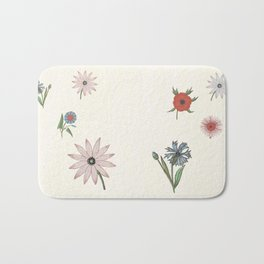The gift of flowering blooms Bath Mat