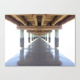 under the pier surrounded by white Canvas Print