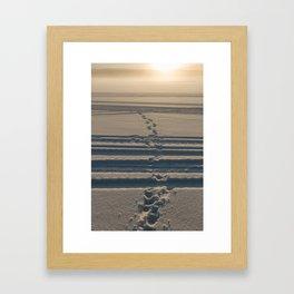 Footsteps in snow Framed Art Print