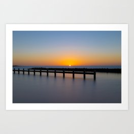 Landscape photography: beautiful sunset at a jetty in a big lake. A blue sky with a orange glow.  Art Print