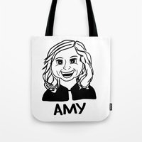 amy poehler Tote Bags featuring Amy Poehler by Flash Goat Industries