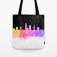 cleveland Tote Bags featuring Cleveland Skyline by Emily Brady
