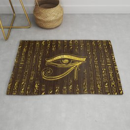 Golden Egyptian Eye of Horus  and hieroglyphics on wood Rug