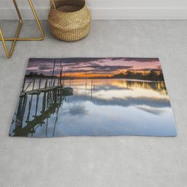 Sunset reflections on the river Rug