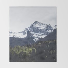 Winter and Spring - green trees and snowy mountains Throw Blanket