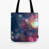 the lights Tote Bags featuring Lights by Jeremy Jon Myers