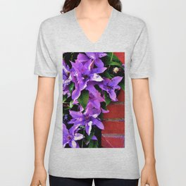 Beautiful purple flowerbush on the wall Unisex V-Neck
