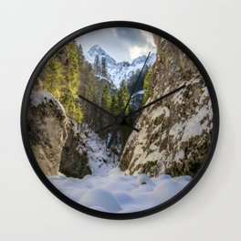 Winter and spring valley and mountains Wall Clock