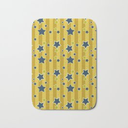 Blue stars on a yellow background Bath Mat