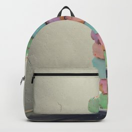 A stack of donuts on wooden table against the wall Backpack