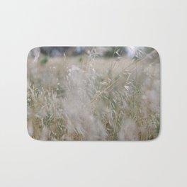 Tall wild grass growing in a meadow Bath Mat