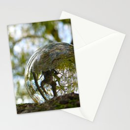 A tree seen through the glass ball Stationery Cards