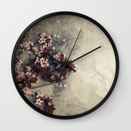branch with cherry pink blooming flowers on rustic background Wall Clock