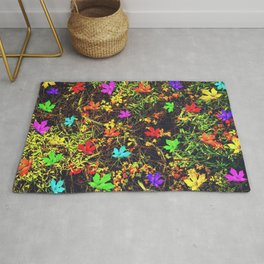 maple leaf in blue red green yellow pink orange with green creepers plants background Rug