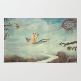 Little girl on the swing in the  fantastic country in sky  Rug