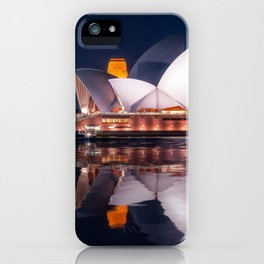 The White Shell Roofs of Sydney Opera House at Night with reflections in the water iPhone Case