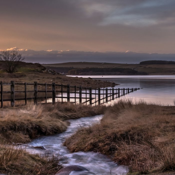 Still waters at the Derwent Reservoir at sunset Comforters