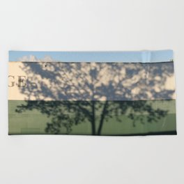 Shadow Tree on an industrial building Beach Towel