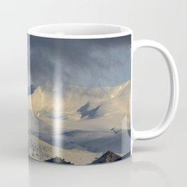 Snowy mountains through the clouds. Coffee Mug