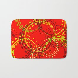 Mustard curls and circles of yellow and brown shades on a red background. Bath Mat