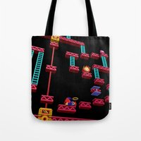donkey kong Tote Bags featuring Inside Donkey Kong stage 3 by Metin Seven